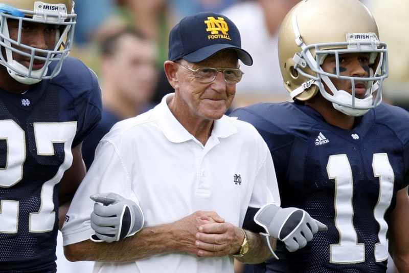 SOUTH BEND, IN - SEPTEMBER 13:  Former head coach Lou Holtz of the Notre Dame Fighting Irish walks out for the coin toss with David Grimes #11, David Bruton #27 and Maurice Crum #40 prior to playing the Michigan Wolverines on September 13, 2008 at Notre Dame Stadium in South Bend, Indiana.  (Photo by Gregory Shamus/Getty Images)